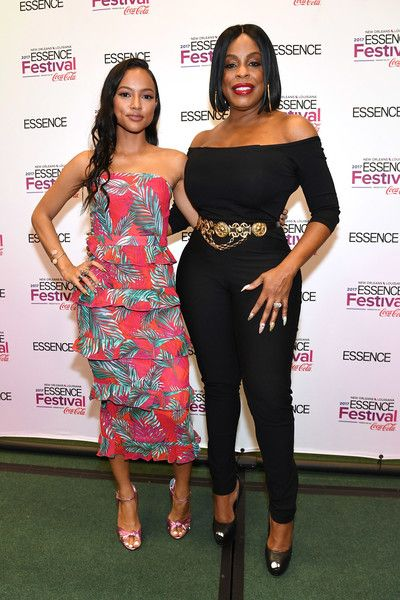 Karrueche Tran and Niecy Nash pose in the press room at the 2017 ESSENCE Festival presented by Coca-Cola at Ernest N. Morial Convention Center on July 1, 2017 in New Orleans, Louisiana.