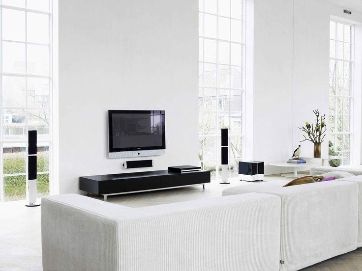 Astounding Black TV Stand On White Floor Tile And Sectional White Faux Leather Sofas And White Glass Lite Window Frames In Open Plan Contemporary White Living Room Ideas