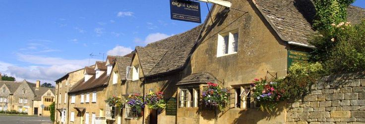 The Eight Bells was built in the 14th century to house the stonemasons that built St. James' church and was later used to store the peel of the eight bells that were hung in the church tower, hence its name. The Inn was rebuilt using most of the original stone during the 17th century. What exists today is an outstanding example of a traditional Cotswolds Inn. Its large terraced garden allows striking views of the nearby church.The pub is handy for the Cotswold Way walk, leading to Bath.