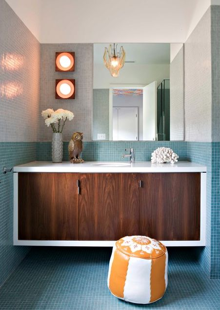 15 Refreshing Ideas for a Bathroom Makeover  Mid-mod accessories. A floating white and wood vanity and color-block tile wall set a modern tone in this Los Angeles residence — but it's the midcentury-style ceramic vase and wooden owl that steal the show.  http://www.houzz.com/photos/21590686/Brentwood-Residence-midcentury-bathroom-los-angeles