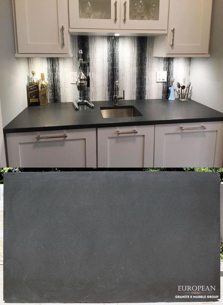 Want a unique countertop surface? This kitchen countertop ... on Black Granite Countertops Kitchen  id=94924