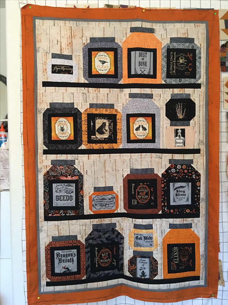 """Finished piecing my """"Halloween Apothecary Jar"""" quilt made from the pattern called """"Stocked Up"""" by Coach House Designs. Used a variety of fallish/Halloween fabrics."""
