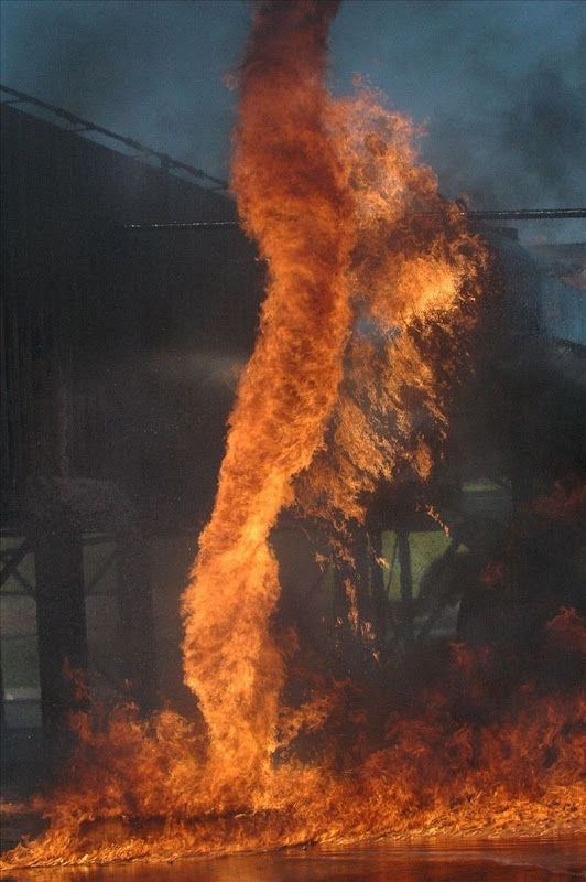 Fire tornado. They occur when a column of warm, rising air contacts with - or creates - fire on the ground.