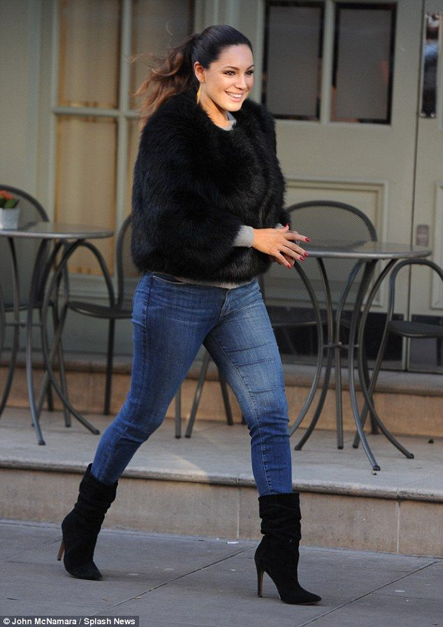 Back to business: Kelly Brook kept it casual in jeans on Wednesday morning as she headed out in Central London