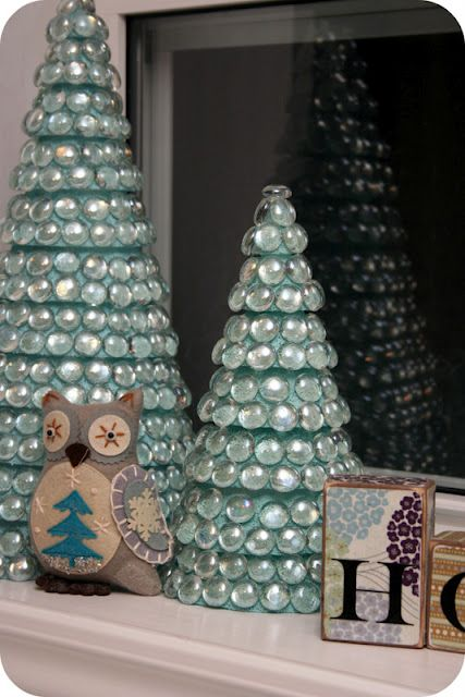 Dollar Store DIY Christmas Tree Decor! What you will need: Styrofoam cones, Craft paint & Brush (optional, you can leave white also) Glue gun, Glue sticks Glass bowl fillers (Ones that are flat on bottom). The process is so simple. Paint the styrofoam (optional), let dry, glue on the glass. Pretty and Shiny!