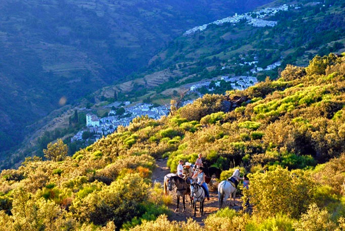 "El barranco de Poqueira, la Alpujarra de Granada.The inspiring landscape with its contrasting views, the rich environmental heritage as well the open friendliness of the people make this an ideal location to spend a ""rural"" holiday in many different ways."