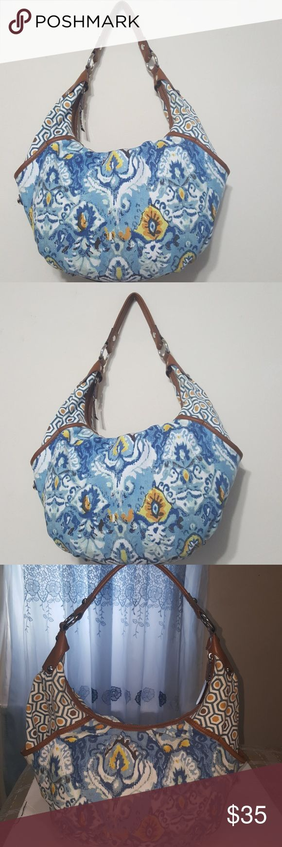 🎀Tignanello🎀 womens hobo bag Beautiful flowers print   Tignanello Handbag  with brown  leather straps is in great condition inside and out. Tignanello Bags Shoulder Bags