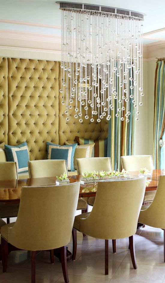 A contemporary crystal chandelier updates  a transitional dining room. //Decorating and Design Tips from Tobi Fairley - Traditional Home®