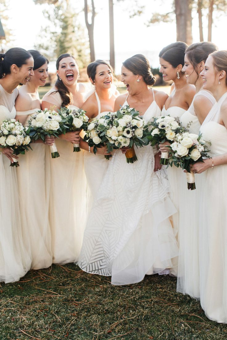 White bride and cream bridesmaid dresses