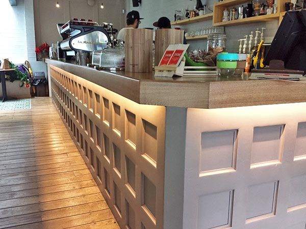 Under counter warm white LED strip light creates an inviting environment at a local cafe.