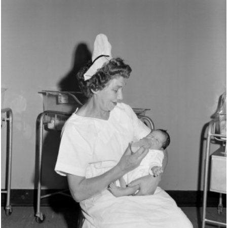 Nurse feeding newborn baby in hospital Canvas Art - (24 x 36)