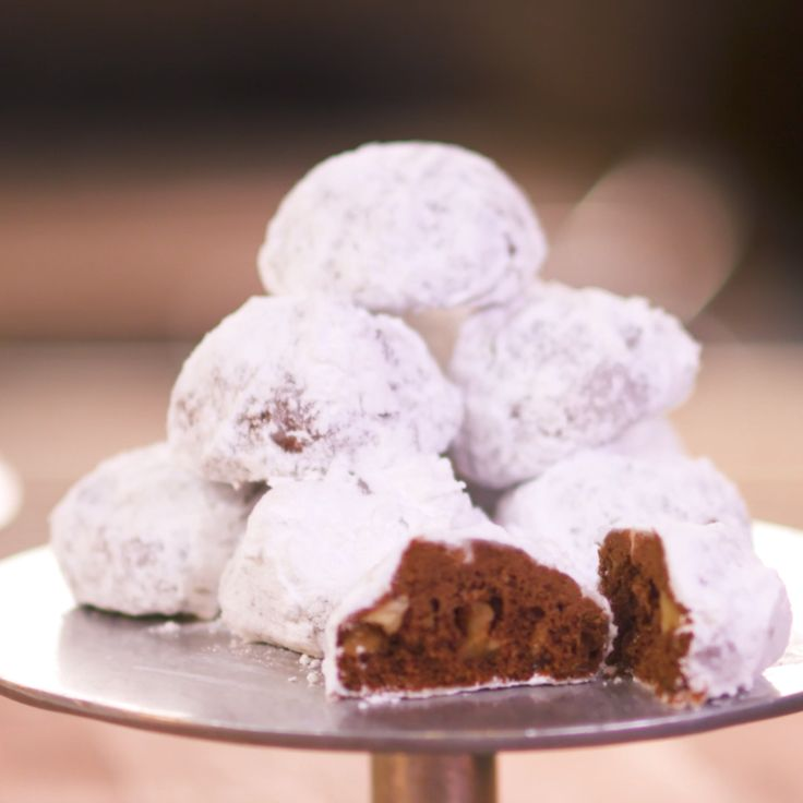 """Nothing says """"holiday season"""" quite like Pecan Snowball Cookies! Cocoa powder and crunchy Fisher Walnuts give this classic recipe a new twist, making it a perfect holiday dessert for all of the chocolate lovers in your family!"""