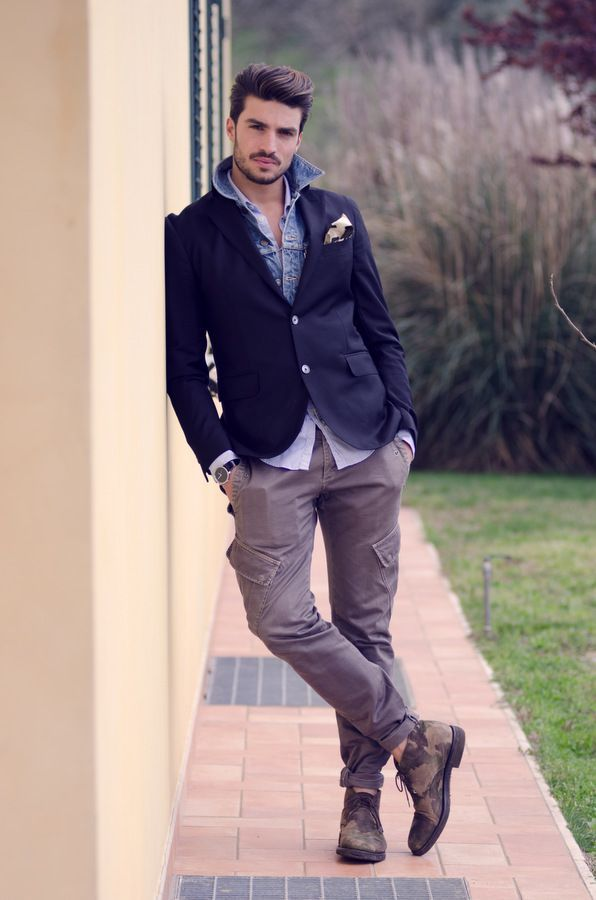 Opt for a navy blazer and grey cargo pants for a trendy and easy going look. Finish it off with dark brown camouflage leather desert boots.  Shop this look for $250:  http://lookastic.com/men/looks/pocket-square-and-denim-shirt-and-longsleeve-shirt-and-blazer-and-cargo-pants-and-desert-boots/3808  — Beige Pocket Square  — Blue Denim Shirt  — Light Blue Longsleeve Shirt  — Navy Blazer  — Grey Cargo Pants  — Dark Brown Camouflage Leather Desert Boots