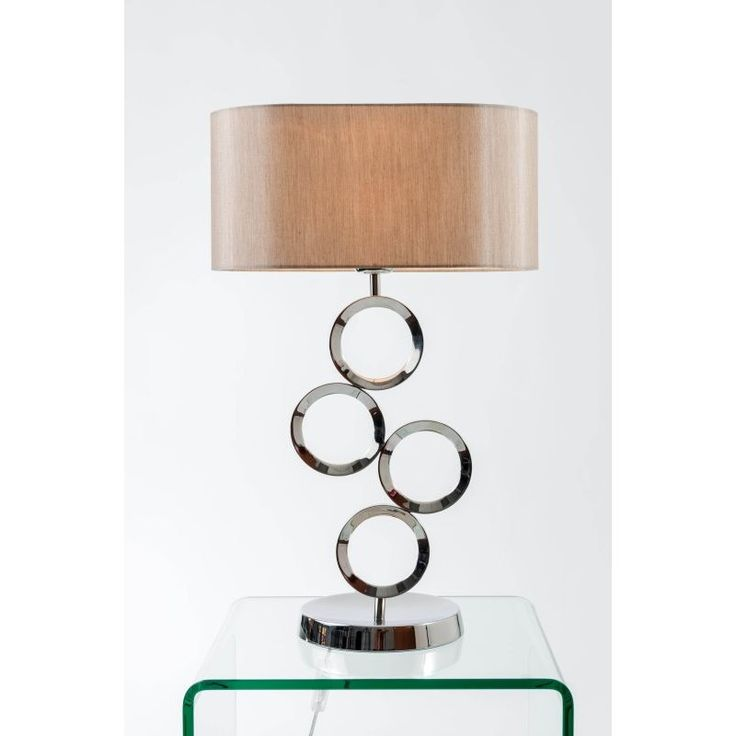 This thornton polished chrome table lamp composed of a series of balancing hoops makes a playful