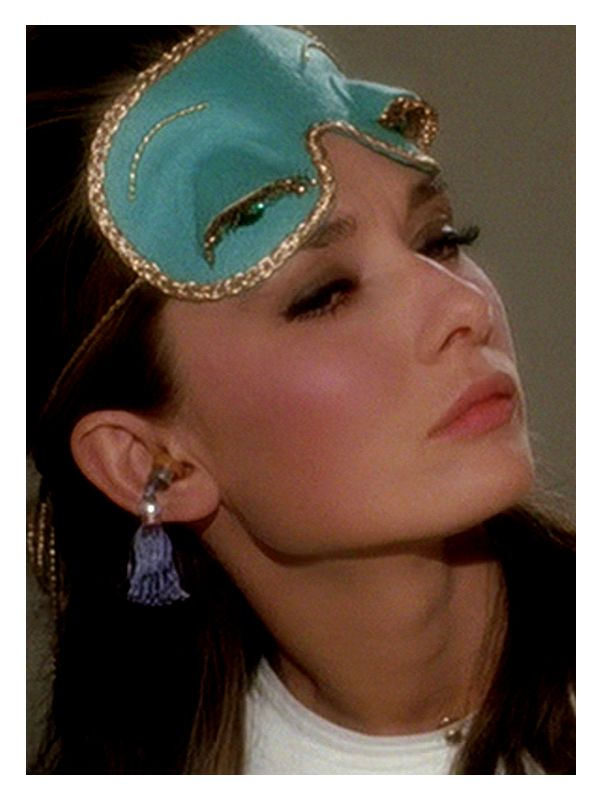 Breakfast at Tiffany's Her cheeks! Oh, her eyelashes. Great focus points for make up. :) -pq