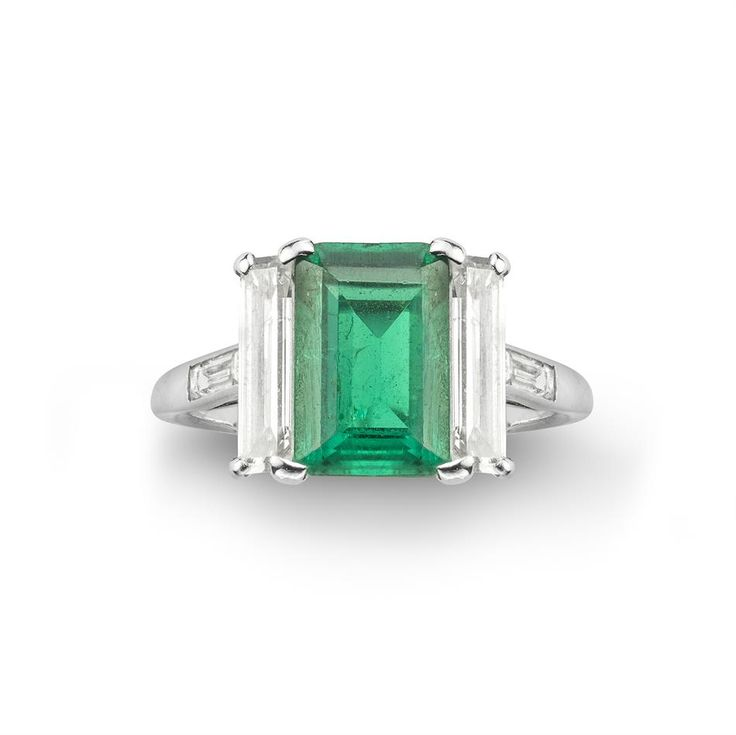 A Cartier art deco emerald and diamond ring / like the way the baguettes line up with the emerald cut stone