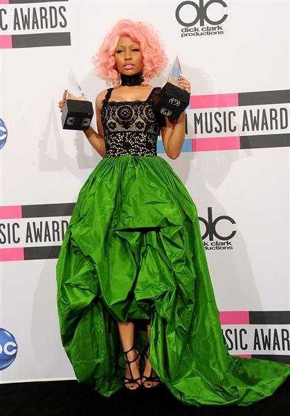 I know many would disagree, but Nicki Minaj looks just exactly how Nicki Minaj should at an event like this: Glomorously couture, totally out of the box, and not like anyone else, at ALL.  She owes Oscar de la Renta a big hug.