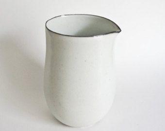 White porcelain pitcher with black rim
