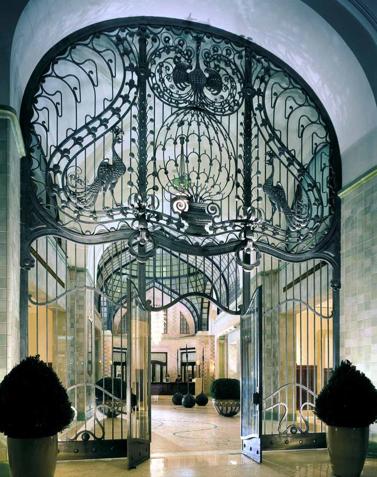 Iron gate entrance at the Four Seasons Hotel in Budapest, originally designed by Zsigmond Quittner and built in 1906 (via http://www.gayot.com/blog/four-seasons-hotel-budapest-hungary-gresham-palace/)
