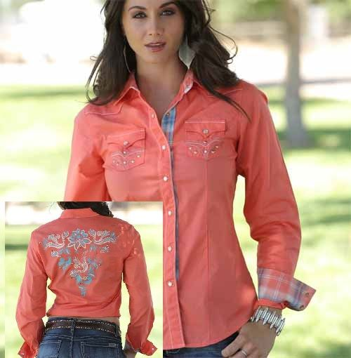 A top of the line Ladies Western Shirt from Cruel Girl. This snap shirt features a beautiful back embroidery design with contrast stitching, studs, and cream snaps. The plaid lining inside the collar and cuffs are great for cowgirls who like to roll up their sleeves.  Pair this Cruel Girl Western Snap Shirt up with Cruel Girl Jeans. http://www.tackroominc.com/cruel-girl-coral-western-shirt-with-back-embroidery-p-18844.html