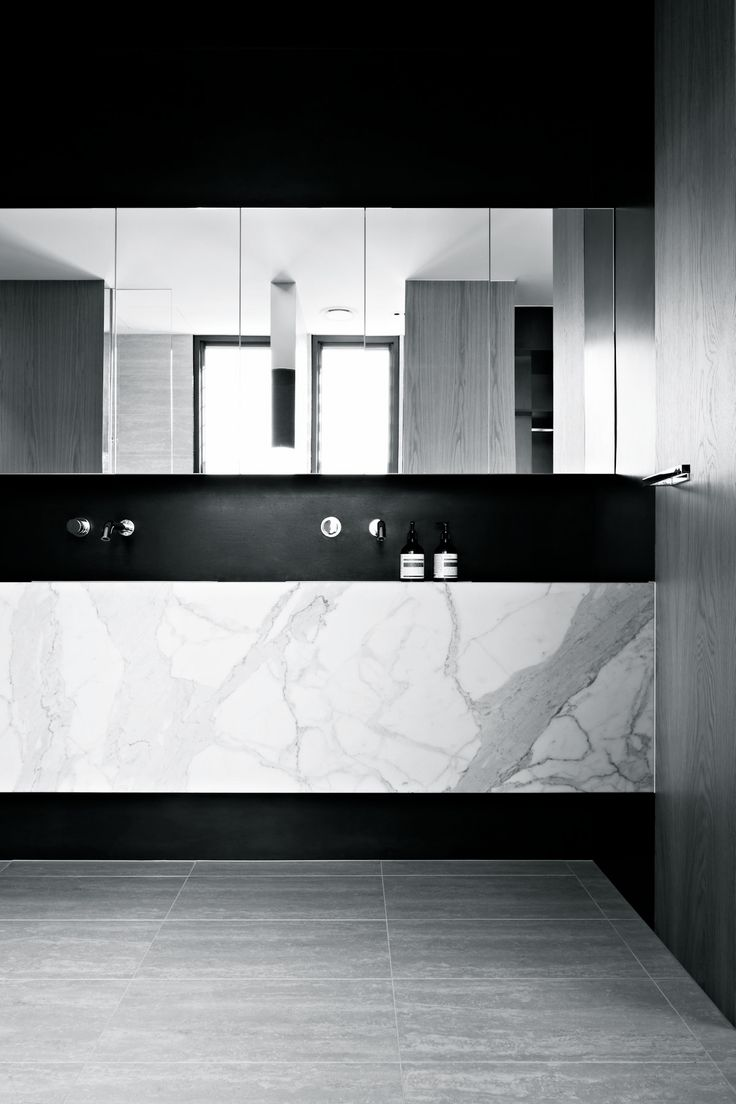 Black and marble bathroom. Great line of mirror cabinets above sink. AGUSHI | Oban House