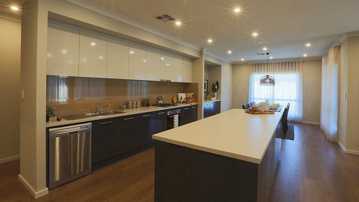 This stylish and practical kitchen overlooks the dining and living areas for connected living. Keep an eye on the whole family while cooking up a storm! #kitchen #home #homedecor #style #weeksmacklinhomes
