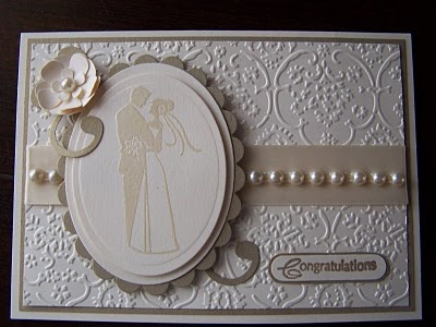This card is so sweet and I love the subtle look of Inkadinkado couple with white embossing.