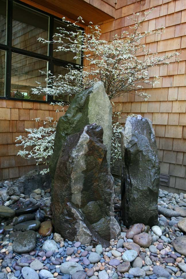 Rocks don't always have to be horizontal, use them as a sculptural elements in the landscape
