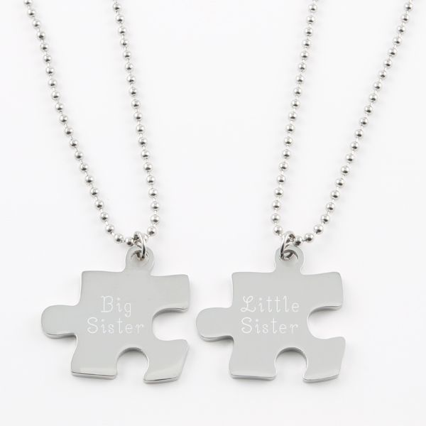 Puzzle Piece Necklace Set of Two - These necklaces are the ideal way to celebrate the connection you've got with your spouse, significant other, best friend or sibling. You keep one and share the other. Set contains 2 puzzle necklaces that fit together.