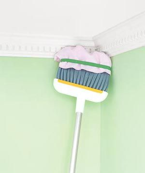 Broom dusting crown molding & tons of other household cleaning tricks.