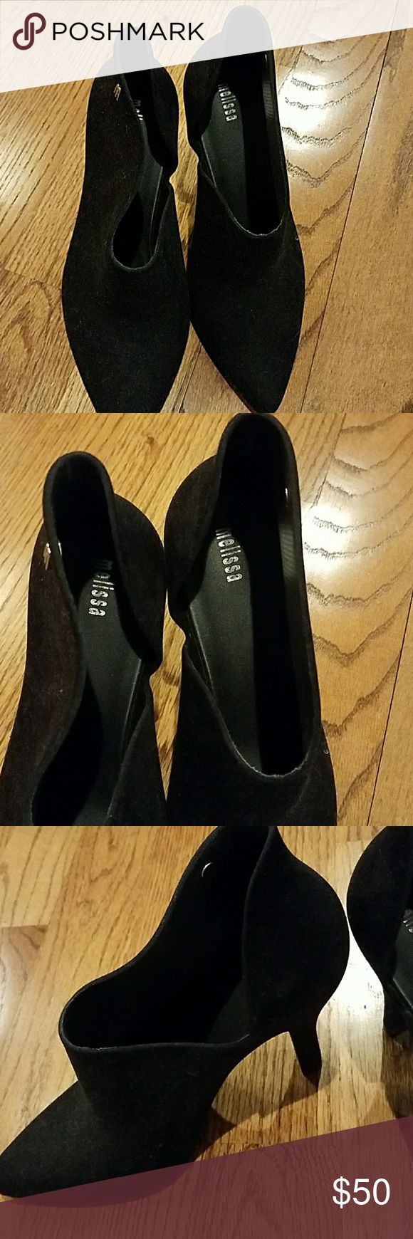 Melissa Black Heels Black velvet pumps.  Melissa brand made in Brazil.  Never worn.  They fit pretty snug but feel they will loosen up after being worn.  Melissa shoes are rubber and these are velvet on the outside. 4 inch heel. Melissa Shoes Heels