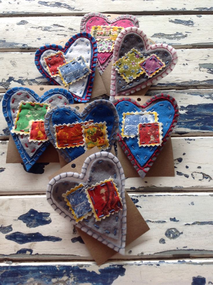 Felt heart brooches. We love these.