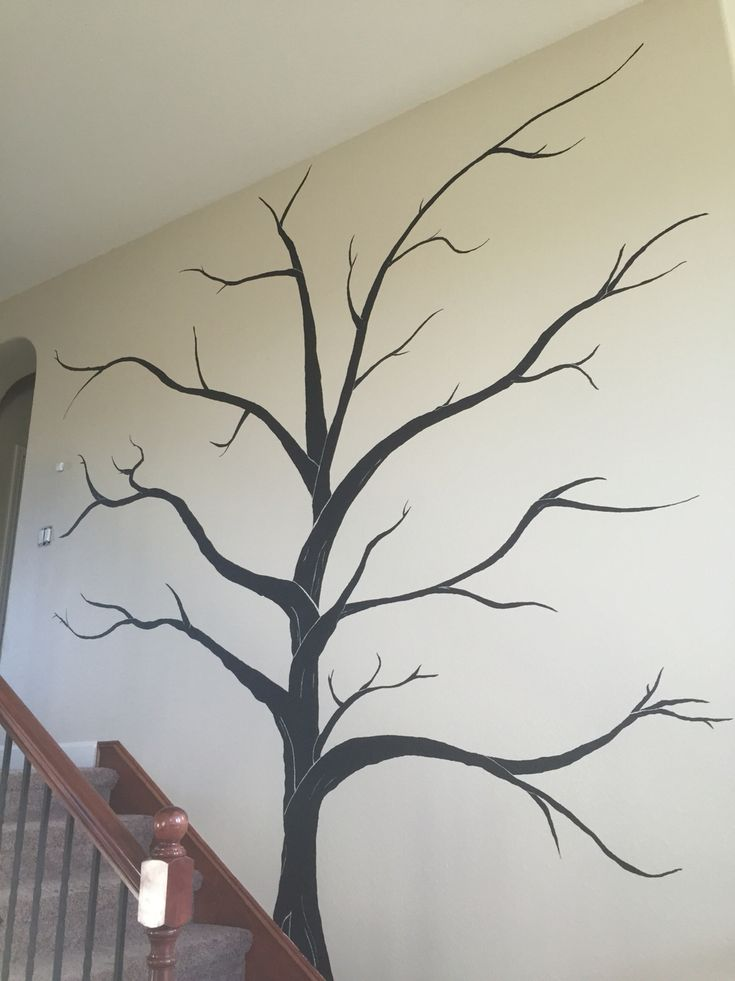 "We painted this huge tree on our wall going up the stairs.  We plan to hang framed pictures on the branches to make our own ""family tree"""