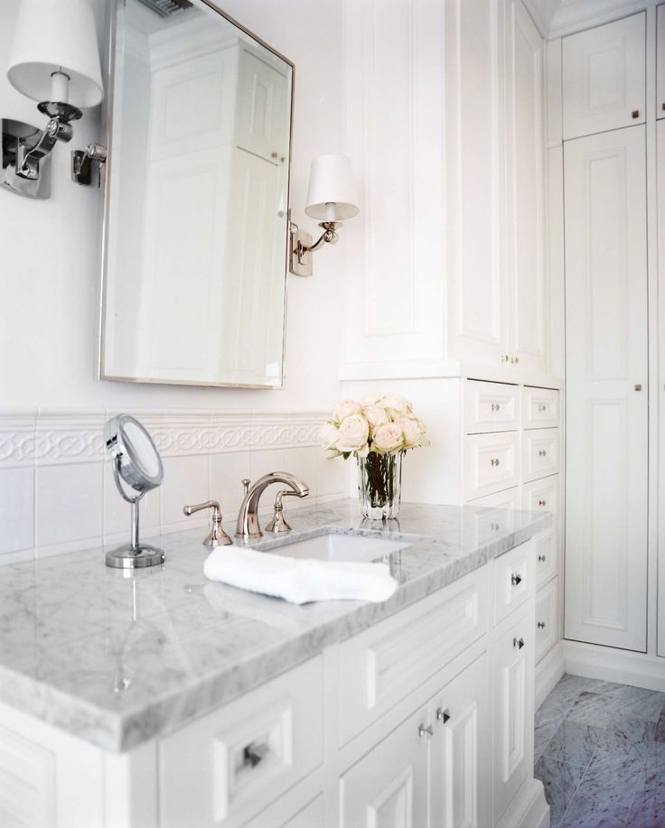 Gallery Website traditional white bathroom with rectangular pivot mirror over carrara marble counter top this but double vanity