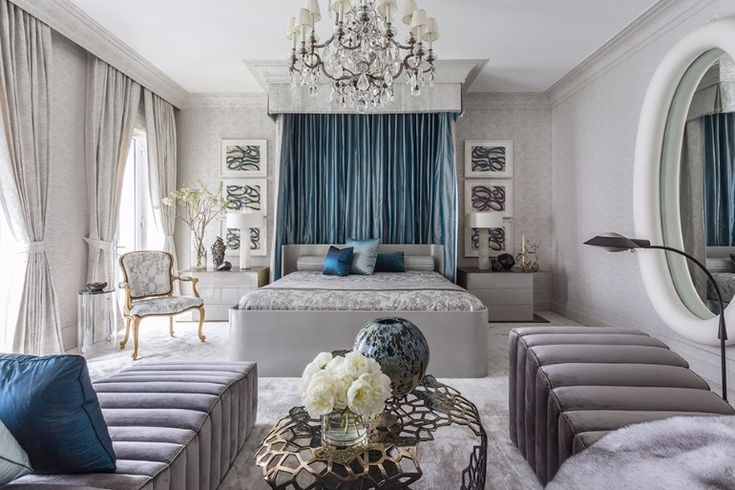 A more opulent approach to Jamie Drake's master bedroom design, where an all-grey bedroom with classic curtains, bed and chandelier meet more modern pieces. This combination of new and classical is his signature style.