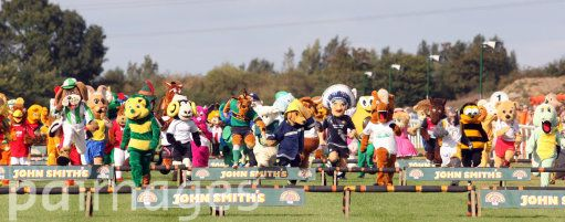 Runners clear a fence during the Mascot Grand National at Huntingdon Race Course, Cambridgeshire.