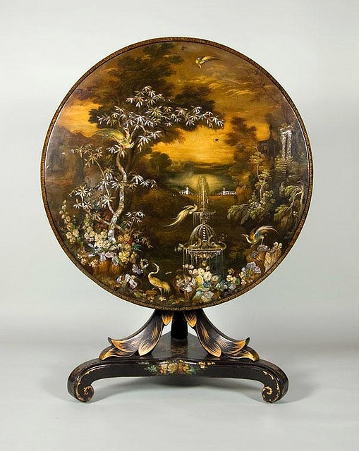 Japanned ware tip-top table 1845, slate top lacquered and decorated with a fountain in pearl, exotic birds and a bronze sky with gold leaf border. Decorated papier-mâché veneer base.