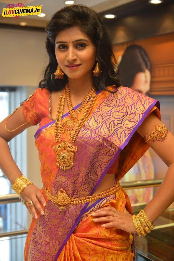 Shamili Sounderajan in Gorgeous Mango Orange Silk Saree with Purple Border and Gold Jewelry