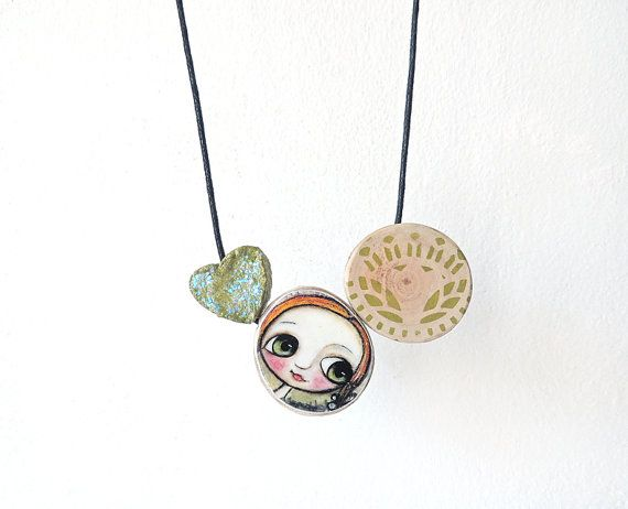 Wood necklace with reproduction of my artwork. Little child with big eyes.