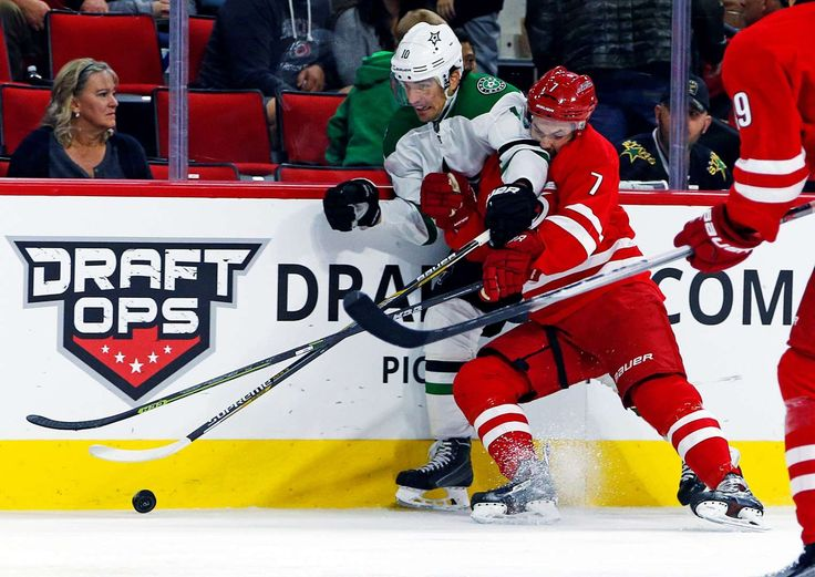 Fight for the puck:   Dallas Stars' Patrick Sharp (10) collides with Carolina Hurricanes' Ryan Murphy (7) during the second period of an NHL hockey game Nov. 6, 2015, in Raleigh, N.C. - © Karl B. DeBlaker/AP Photo