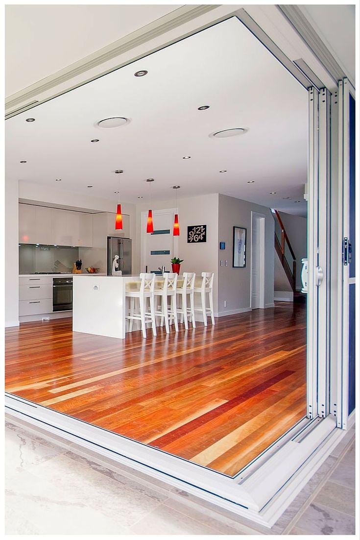 Sliding stacker doors open up your indoor and outdoor areas. Door by Wideline. Home by Buildcraft.