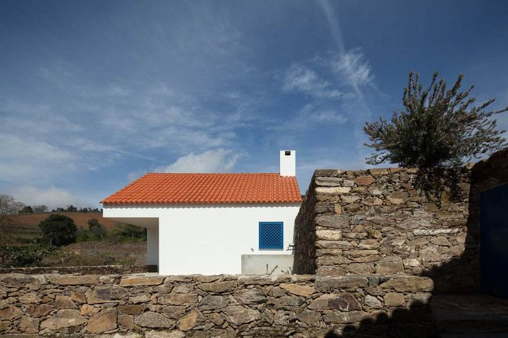 This caretaker's residence on a vineyard in Portugal was designed to complement the older buildings on the site. It has 2 bedrooms in 753 sq ft.   www.facebook.com/SmallHouseBliss