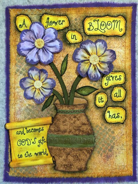 A fabric page created using Distress Inks and Embossing Powders.