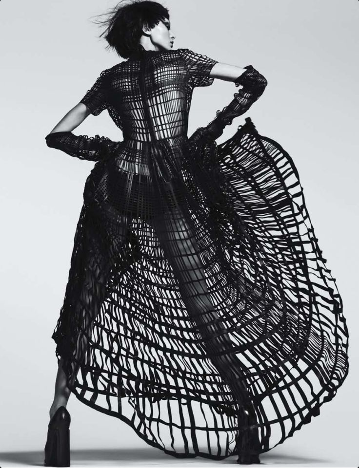 Fashion as Art - open grid dress with voluminous shape; dramatic fashion photography // Ph. Trunk Xu for Numero China