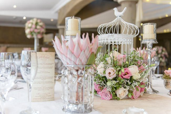 Pink, blush and cream wedding reception table details with stunning King Protea // Lightburst Photography  - ethereal South African wedding