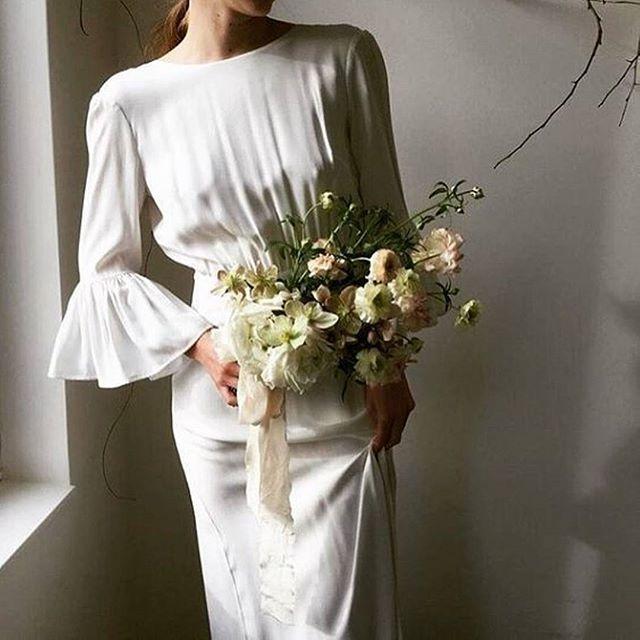 Elegance and grace Flowers: @hart_floral Gown: @lenamedoyeffbridal #weddinggown #bridalinspiration #effortless #classicbride #bridalflowers #modernbride ( @ido_events_ via @latermedia )