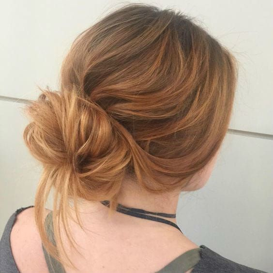 This low, loose bun by Aveda Artist Sarah Naslund (@mybighairday) is perfect for holiday travel. It looks chic but isn't fussy and keeps your hair out of your face at the baggage claim.
