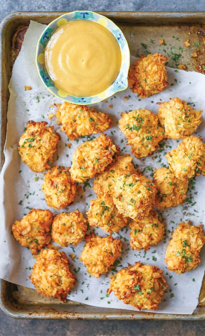 This baked popcorn chicken recipe is a healthier alternative to the deep-fried version with the best crispy potato chip crust!!