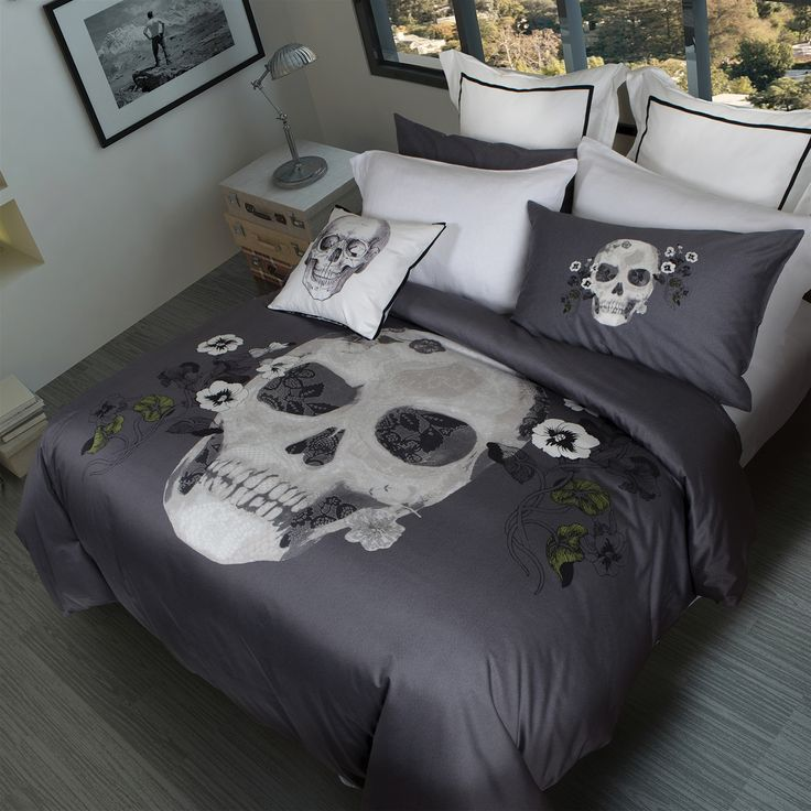 Home Republic Forever Collection: A contemporary skull design adorns the center of the duvet, layered with lace details and surrounded by hand drawn flowers. The gender neutral background is a textured print in shades of grey. Complete the look with Euro pillows framed with black grosgrain ribbon and Square pillow printed with a vintage scientific skull. All pieces feature a clean knife edge and zipper openings.