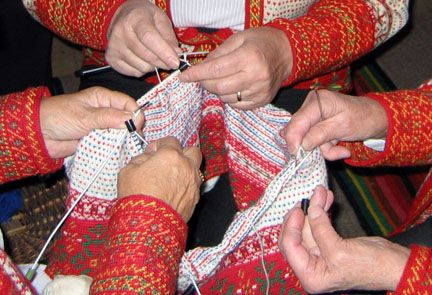 This is very intricate knitting, Korsnas style. The base is crocheted, than knit on multiple needles using six hands!